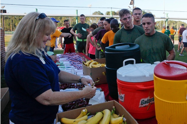 Participants in the 2nd Quarterly Road Race replenish themselves with fruit and drinks after completing the 4-mile course aboard Marine Corps Recruit Depot Parris Island, May 22. The event had more than 180 participants from the Air Station and Parris Island.