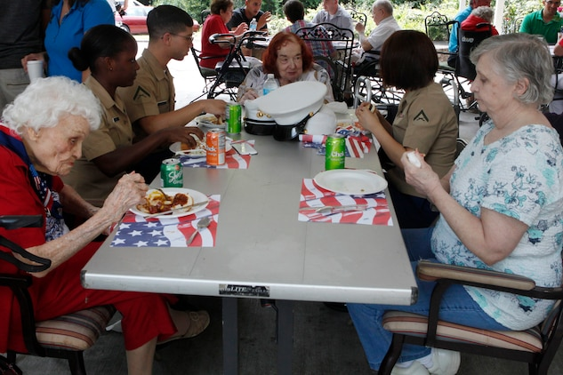 Marines with the Single Marine and Sailor program participate in a barbeque at the River Oaks assisted living community, May 23. The program funded by Marine Corps Community Services  provided the burgers and hotdogs.