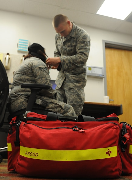 Airman 1st Class Joshua Mittelsteadt, 509th Medical Operations Squadron ambulance services technician, practices a routine check on a patient with simulated breathing problems at Whiteman Air Force Base, Mo., May 23, 2013. Whiteman ambulance services respond to approximately seven calls per week, and see an increase in calls during the summer. (U.S. Air Force photo by Airman 1st Class Bryan Crane/Released)