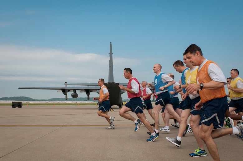 Members of the 123rd Airlift Wing conduct a mass physical fitness test by running on the flight line of the Kentucky Air National Guard Base in Louisville, Ky., on May 19, 2013. The mass testing is designed to improve efficiency while giving Airmen the edge to succeed. (U.S. Air National Guard photo by Airman Joshua Horton)