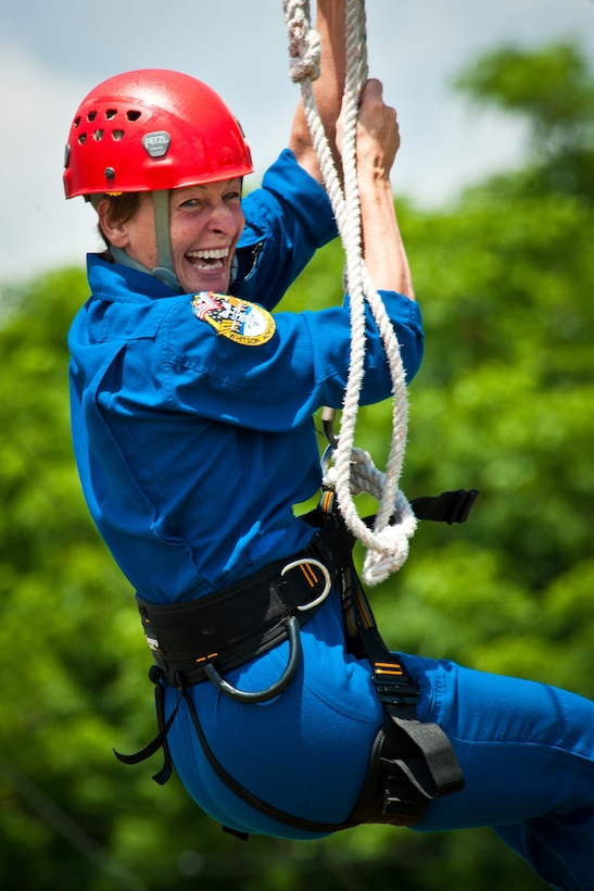 Astronaut Peggy Whitson, from the NASA Johnson Space Center in Houston, Texas, navigates the ropes course confidence at Maxwell's Officer Training School training grounds May 23, 2013. Whitson was leading a team of six U.S. and international astronauts through leadership and teamwork training obstacle courses here to evaluate the potential for future use. (U.S. Air Force photo by Donna Burnett)