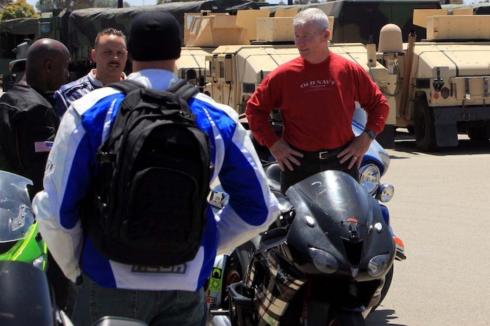 Lt. Gen. John A. Toolan, commanding general of I Marine Expeditionary Force, speaks with members of the I MEF/ I Marine Expeditionary Force Headquarters Group Motorcycle Club before a group ride at Camp Pendleton, May 30. The Marines began their ride at Camp Pendleton and rode approximately 25 miles around the southern portion of base. The purpose of the ride was to build camaraderie within the unit and educate the riders on basic motorcycle maintenance, and safety.