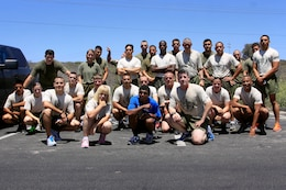 Volunteer's from Law Enforcement Battalion and Security Battalion here gathered for a group photograph after running 17 miles across Camp Pendleton with the Special Olympics torch in support of the 2013 summer games here May 29.