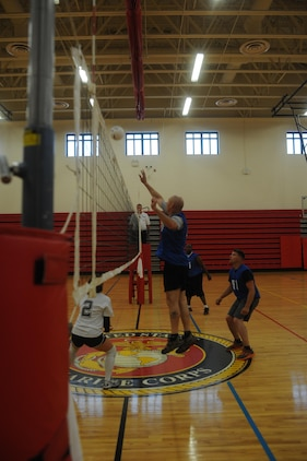 The Basic School and the Marine Corps Systems Command compete during an intramural volleyball game at Barber Physical Activities Center aboard Marine Corps Base Quantico on May 28, 2013. MCSC won the game after a close second set.