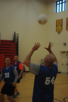 Sgt. Maj. Wayne Pedersen, coach of The Basic School volleyball team, sets a ball during a game against the Marine Corps Systems Command at Barber Physical Activities Center aboard Marine Corps Base Quantico on May 28, 2013. MCSC won the game after a close second set.