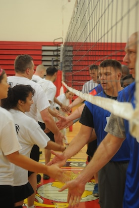Members of the Marine Corps Systems Command and The Basic School volleyball teams shake hands after a game at Barber Physical Activities Center aboard Marine Corps Base Quantico on May 28, 2013. MCSC won the game after a close second set.
