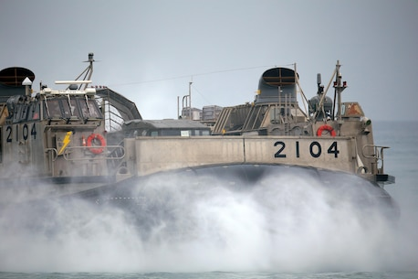 A Japanese landing craft air cushion (LCAC) lands on Red Beach as part of the initial offload for Exercise Dawn Blitz here, May 31, 2013. Dawn Blitz 2013 is an amphibious exercise testing U.S. and coalition forces in skills expected of a Navy and Marine Corps amphibious task force. Forces will conduct amphibious assaults, live-fire opportunities, mine operations, Maritime Prepositioning of Force (MPF) training and sea-basing operations. (Photo by U.S. Marine Corps Cpl. Jonathan R. Waldman, 11TH MEU, Combat Camera/Released)