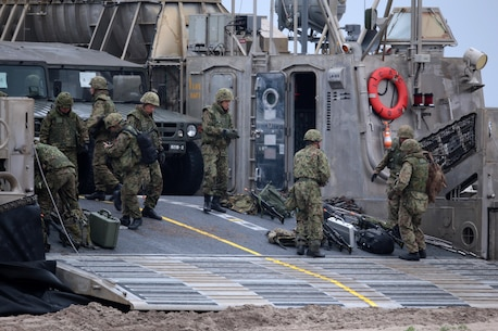 Japanese Ground Self Defense Force (JGSDF) soldiers unload weapons and vehicles from a landing craft air cushion (LCAC) as part of Exercise Dawn Blitz here, May 31, 2013. Dawn Blitz 2013 is a multinational amphibious exercise off the Southern California coast that refocuses Navy and Marine Corps and coalition forces in their ability to conduct complex amphibious operations essential for global crisis response across the range of military operations. (Photo by U.S. Marine Corps Cpl. Jonathan R. Waldman, 11TH MEU, Combat Camera/Released)
