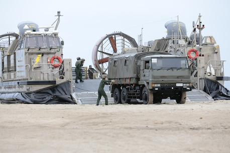 Japanese Ground Self Defense Force (JSDF) soldiers unload weapons and vehicles from a landing craft air cushion (LCAC) as part of Exercise Dawn Blitz, Camp Pendleton, CA, May 31, 2013. Dawn Blitz 2013 is a multinational amphibious exercise off the Southern California coast that refocuses Navy and Marine Corps and coalition forces in their ability to conduct complex amphibious operations essential for global crisis response across the range of military operations. (Photo by U.S. Marine Corps Gunnery Sgt. Chance W. Haworth, 11TH MEU, Combat Camera/Released)