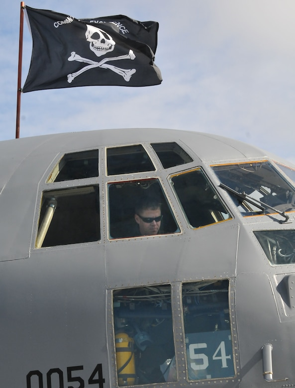 """JOINT BASE ELMENDORF-RICHARDSON, Alaska -- The distinctive pirate flag of C-130 #54 flies here for the last time May 23, 2013. The """"Pirate Ship"""" was one of three C-130 cargo aircraft the Alaska Air National Guard's 176 Wing transferred to the Ohio Air National Guard's 179th Airlift Wing per National Guard Bureau Mandate. National Guard photo by Staff Sgt. N. Alicia Goldberger."""