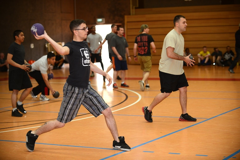 SPANGDAHLEM AIR BASE, Germany -- U.S. Air Force Airmen play dodge ball during a sports day competition May 30, 2013. Sports day brought the community together to increase moral and allow team building activities. (U.S. Air Force photo by Airman 1st Class Kyle Gese/Released)