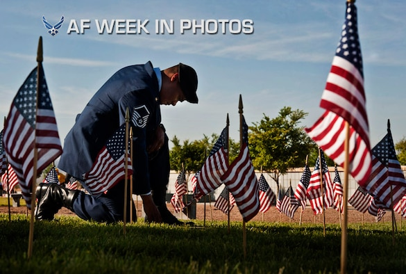 Master Sgt. Robert Lilly pays his respects to a fallen service member May 28, 2013, at the Southern Nevada Veterans Memorial Cemetery in Boulder City, Nev. Lilly and other Airmen from Nellis Air Force Base, Nev., volunteered their time to place flags over veterans' cemetery plots for Memorial Day weekend. Lilly is assigned 57th Operations Group joint tactical air controller (U.S. Air Force photo/Senior Airman Daniel Hughes)