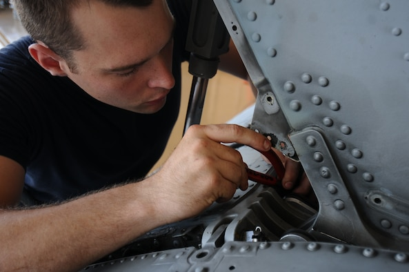 U.S. Navy Petty Officer 3rd Class John Evans, Helicopter Sea Combat Squadron 25 aviation electrician's mate, puts together a position sensor May 30, 2013, on Andersen Air Force Base, Guam. This particular position sensor tells the pilot what angle the tail is at regardless of whether the helicopter is in the air or on the ground. (U.S. Air Force photo by Airman 1st Class Emily A. Bradley/Released)