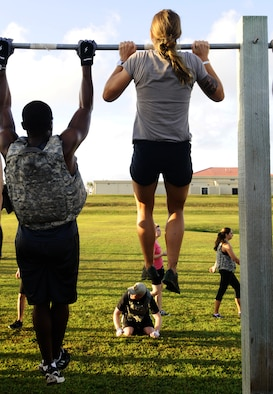 "Participants work to complete pull-ups at the Memorial Day CrossFit ""Murph"" May 23, 2013, on Andersen Air Force Base, Guam. The workout consisted of a one-mile run, 100 pull- ups, 200 pushups, 300 squats, then another one-mile run to pay homage to service members who made the ultimate sacrifice in the line of duty. (U.S. Air Force photo by Airman 1st Class Mariah Haddenham/Released)"