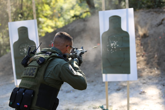 A Marine with the Special Reaction Team fires an M16 during a sustainment training exercise in Charleston, S.C., Oct. 23. The SRT is a part of the Provost Marshal's Office and provides a quick-reaction force for extreme situations.