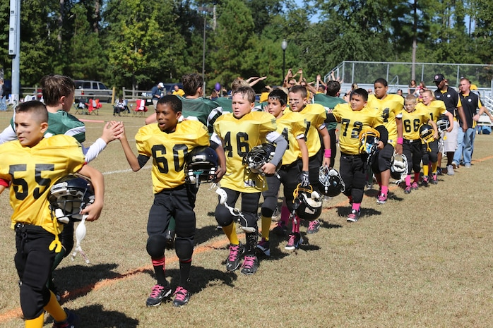 The Laurel Bay Steelers demonstrate good sportsmanship after a win over their opponents in the Beaufort County 9-10 youth football championship game, Oct. 28, at Beaufort, S.C. The Steelers went on to win the championship ending their season with a 8-1 record.
