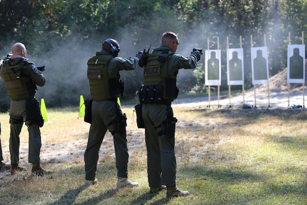 Marines with the Special Reaction Team fire an M9 pistol during a sustainment training exercise in Charleston, S.C., Oct. 23. The SRT is a part of the Provost Marshal's Office and provides a quick-reaction force for extreme situations.