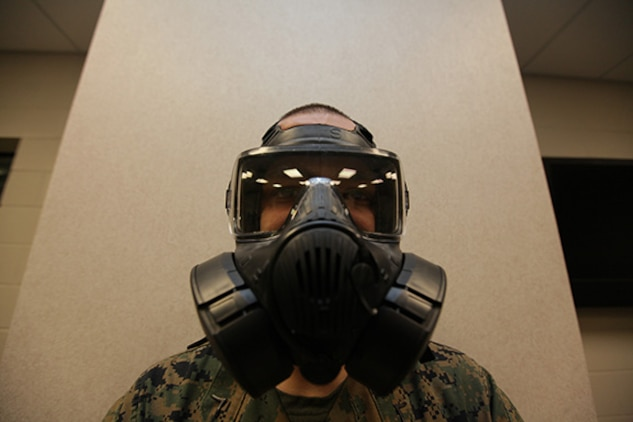 Private First Class Justin Morris, Marine Aviation Logistics Squadron 31 nuclear, biological and chemical defense specialist, wears the new Joint Service General Purpose Mask aboard the Air Station, Jan. 13. Headquarters and Headquarters Squadron Marines are now issued the new masks to keep Marines current on sustainment training.