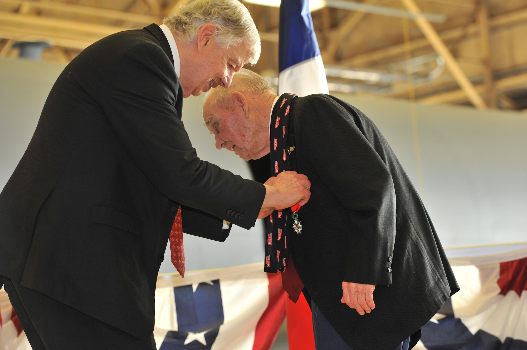 Jack Cowan of the Honorary Consul of France, presents the French Legion of Honor Medal to retired Maj. Clarence Grimes Oct. 25, 2013, at Fairchild Air Force Base, Wash. The 92-year old was honored with the highest recognition by the French government for his contributions almost 70 years ago to defend and preserve the independence of France.
