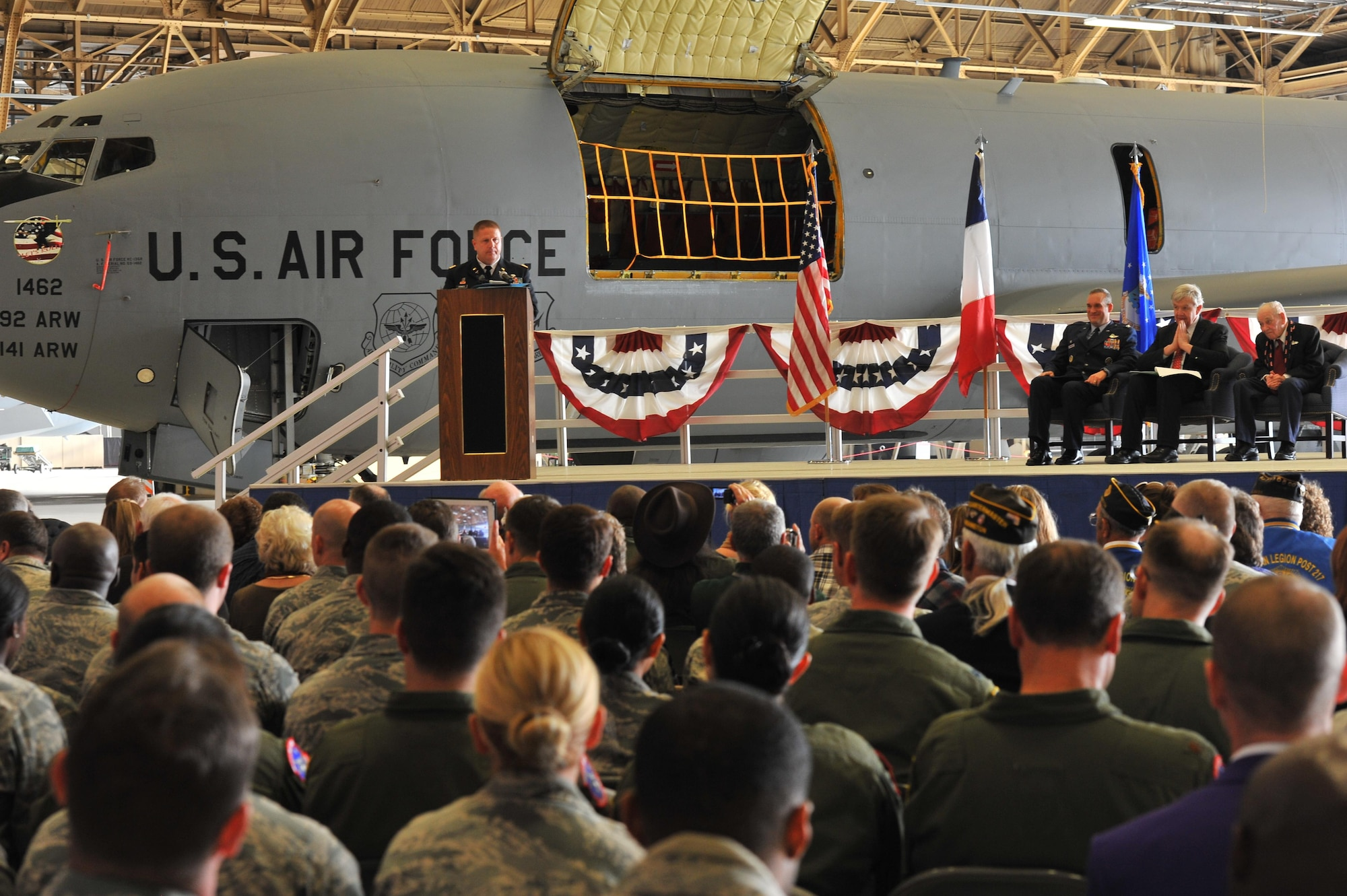 Army Lt. Col. Jeffery Grimes speaks about his uncle, Air Force retired Maj. Clarence Grimes Oct. 25, 2013, at Fairchild Air Force Base, Wash., before his uncle is awarded the French Legion of Honor Medal. The medal is the highest recognition by the French government and was awarded for contributions almost 70 years ago to defend and preserve the independence of France.