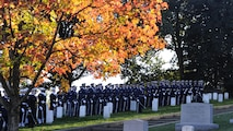 The U.S. Air Force and Navy Honor Guard Drill Team pay tribute to retired Gen. David C. Jones as he is laid to rest Oct. 25, 2013, at Arlington National Cemetery, Va. Jones served four years as chief of staff of the Air Force from 1974 to 1978 until he was appointed as chairman of the Joint Chiefs of Staff, June 21, 1978. As chairman, he served as the senior military adviser to the president, the National Security Council and the secretary of defense.  During the Korean War, Jones was assigned to a bombardment squadron where he accumulated more than 300 flight hours on missions over North Korea.