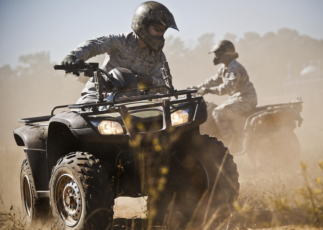 Staff Sgt. Robert Molina practices sharp turning during an ATV training class Oct. 25, 2013, at Eglin Air Force Base, Fla.  Approximately 20 Airmen from the 96th Security Forces Squadron and the 96th Ground Combat Training Squadron received the training over two days.  The new riders learned riding fundamentals and even some complicated techniques during the four-hour course. Molina is assigned to the 96th Ground Combat Training Squadron.
