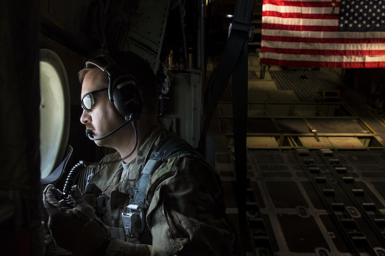 Tech. Sgt. Thomas Hough scans for threats during a retrograde mission to Baghdad International Airport, Iraq, Oct. 28, 2013. The 737th Expeditionary Airlift Squadron is assigned to the 386th Air Expeditionary Wing and is a tactical airlift hub responsible for transporting passengers and cargo across U.S. Central Command. Hough, an Eagle River, Alaska native, is deployed from the 176th Wing, Alaska Air National Guard. Hough is a 737th EAS C-130H Hercules loadmaster.