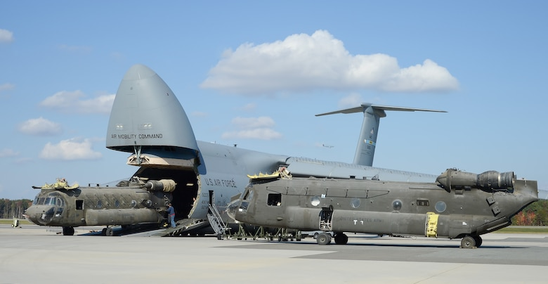 Army CH-47D Chinook helicopters and their components are unloaded from a C-5M Super Galaxy Oct. 29, 2013, at Dover Air Force Base, Del. The helicopters were used in Afghanistan and are being returned to the United States as military forces are withdrawn from the country. The C-5s are assigned to the 436th Airlift Wing.