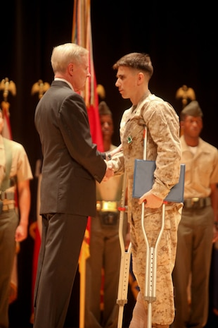 MARINE CORPS BASE CAMP LEJEUNE, N.C. – Cpl. Gaven Eier, a native of Charleston, S.C., is presented the Navy and Marine Corps Commendation Medal by the Secretary of the Navy, the Honorable Ray Mabus, at an award ceremony aboard Camp Lejeune, N.C., Nov. 1, 2013. Elias was one of four to be presented with awards for heroic and selfless actions while deployed to Afghanistan in 2011, with 2nd Battalion, 8th Marine Regiment.