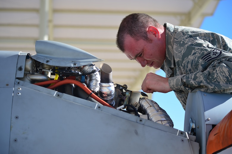 LAS VEGAS, Nev -- A crew chief from the 432nd Aircraft Maintenance Squadron inspects the engine of an MQ-1 Predator remotely piloted aircraft during a post-flight inspection Nov. 1, 2013. The MQ-1 Predator is an armed, multi-mission, medium-altitude, long-endurance RPA that is employed primarily as an intelligence-collection asset and secondarily against dynamic execution targets. The USAF's MQ-9 Reaper and MQ-1 Predator fleet surpassed 2 million cumulative flight hours on Oct. 22, 2013. (U.S. Air Force photo by Staff Sgt. N.B./released)