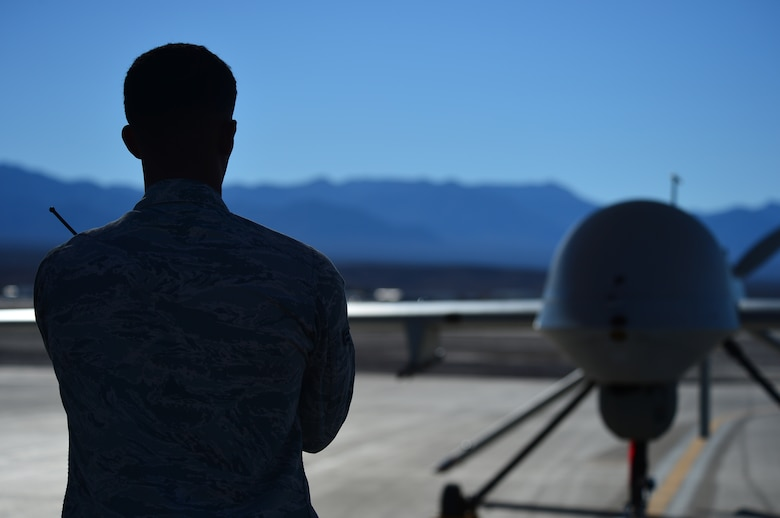 LAS VEGAS, Nev -- A crew chief from the 432nd Aircraft Maintenance Squadron taxis in an MQ-1 Predator remotely piloted aircraft during a post-flight inspection Nov. 1, 2013. The MQ-1 Predator is an armed, multi-mission, medium-altitude, long-endurance RPA that is employed primarily as an intelligence-collection asset and secondarily against dynamic execution targets. The USAF's MQ-9 Reaper and MQ-1 Predator fleet surpassed 2 million cumulative flight hours on Oct. 22, 2013. (U.S. Air Force photo by Staff Sgt. N.B./released)