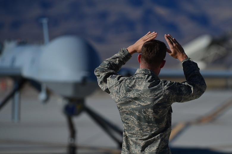 LAS VEGAS, Nev -- Acrew chief from the 432nd Aircraft Maintenance Squadron taxis in an MQ-1 Predator remotely piloted aircraft during a post-flight inspection Nov. 1, 2013. Predators can perform the following missions and tasks: intelligence, surveillance, reconnaissance, close air support, combat search and rescue, precision strike, buddy-lase, convoy/raid overwatch, route clearance, target development, and terminal air guidance. The USAF's MQ-9 Reaper and MQ-1 Predator fleet surpassed 2 million cumulative flight hours on Oct. 22, 2013. (U.S. Air Force photo by Staff Sgt. N.B./released)