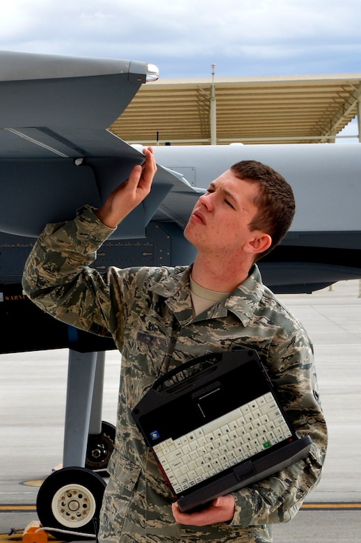 LAS VEGAS, Nev. -- An Airman from the 432nd Aircraft Maintenance Squadron examines the flaps of an MQ-9 Reaper during a post-flight inspection Oct. 28, 2013.  The primary mission of Reapers is close air support, air interdiction, and intelligence, surveillance and reconnaissance. The USAF's MQ-9 Reaper and MQ-1 Predator fleet surpassed 2 million cumulative flight hours on Oct. 22, 2013. (U.S. Air Force photo by Senior Airman A.K./released)