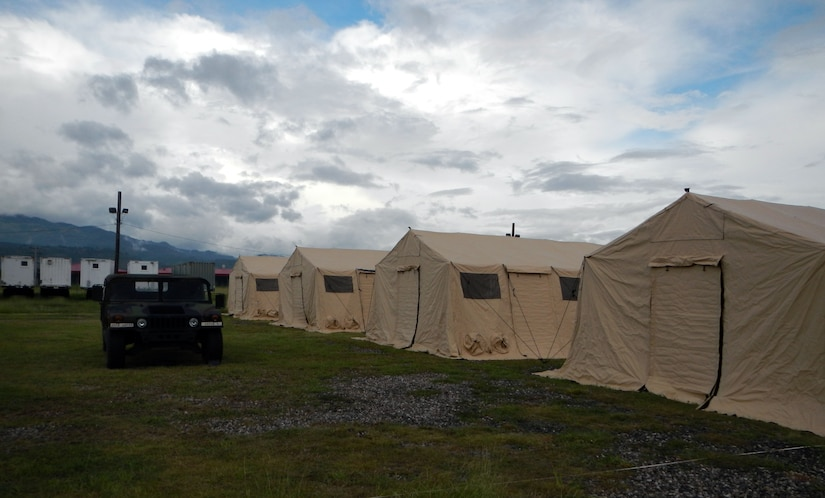 Members of Joint Task Force-Bravo's Army Forces Battalion (ARFOR) set up the Lite Expeditionary Camp system during the week of Oct. 28-Nov. 1, 2013.  The Lite Expeditionary Camp system consists of seven total tents, with the capability to house servicemembers and maintain military operations for up to ten years with proper upkeep.  (Photo by U.S. Army Spc. Christopher Floyd)