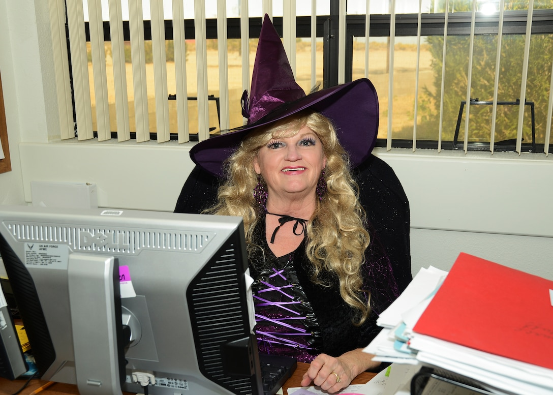 Debbie Barbier, 412th Mission Support Group, stock fund manager, came dressed for Halloween as a purple witch. (U.S. Air Force photo by Rebecca Amber)