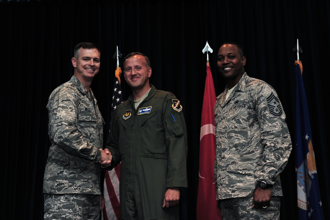 """Maj. Donald Mentch, 414th Expeditionary Reconnaissance Squadron commander deployed from Creech Air Force Base, N.V., is awarded this week's """"Pick of the 'Lik"""" Oct. 31, 2013, at Incirlik Air Base, Turkey.  Mentch provided his technical expertise and repaired 17 bird aversion strike hazard cannons and seven bowling alley lanes. (U.S. Air Force photo by Airman 1st Class Nicole Sikorski/Released)"""