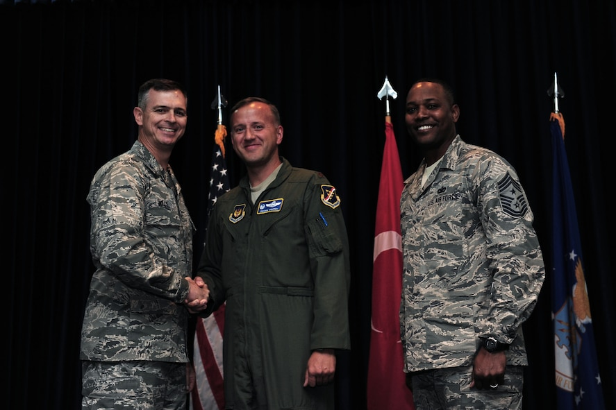 "Maj. Donald Mentch, 414th Expeditionary Reconnaissance Squadron commander deployed from Creech Air Force Base, N.V., is awarded this week's ""Pick of the 'Lik"" Oct. 31, 2013, at Incirlik Air Base, Turkey.  Mentch provided his technical expertise and repaired 17 bird aversion strike hazard cannons and seven bowling alley lanes. (U.S. Air Force photo by Airman 1st Class Nicole Sikorski/Released)"