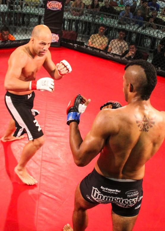 Danny Ruiz looks for a way to attack Ryan Hodge in their bout at Strike Fight II Sept. 21 at Eglin Air Force Base, Fla. Ruiz won by knockout in the first round. Ruiz is an Air Force reservist with the 919th Special Operations Logistics Readiness Squadron at Duke Field Fla. This was Eglin's second mixed martial arts event. (Courtesy photo)