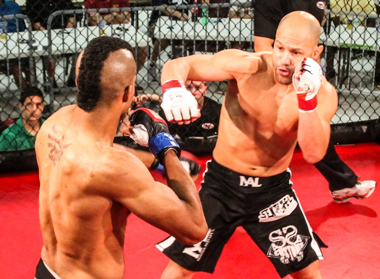 Danny Ruiz jabs at Ryan Hodge in their bout at Strike Fight II Sept. 21 at Eglin Air Force Base, Fla. Ruiz won by knockout in the first round. Ruiz is an Air Force reservist with the 919th Special Operations Logistics Readiness Squadron at Duke Field Fla. This was Eglin's second mixed martial arts event. (Courtesy photo)