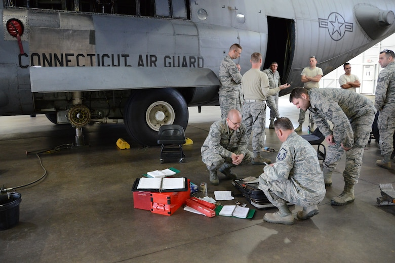 Personnel from the 103rd Maintenance Group begin training on the newly-received C-130H Hercules Friday, Oct. 25, 2013, at Bradley Air National Guard Base, East Granby, Conn. This is the first out of eight C-130H model aircraft expected to be assigned to the 103rd Airlift Wing and that the unit will operate in support of foreign and domestic airlift missions. (U.S. Air National Guard photo by Master Sgt. Erin E. McNamara)