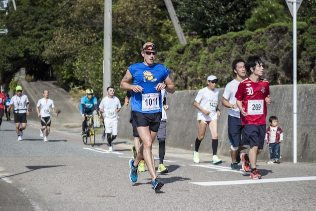 Master Gunnery Sgt. Kevin D. Layne, a maintenance chief with Marine Aviation Logistics Squadron 12, runs during the Hagi Iwami Airport Half Marathon Oct. 20, 2013. Layne said that this was his seventh half marathon of the year, with the other six being in the United States.