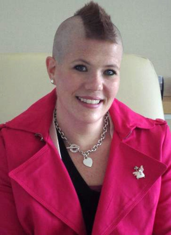 Katie Hampton, Osan Middle School special education teacher and breast cancer survivor, sports her new haircut during her first chemotherapy treatment at Massachusetts General Hospital, Boston, June 29, 2012. Hampton's aunt, Rev. Nell Fields, was instrumental in setting up her initial appointments with doctors at the hospital and creating a smooth transition from Hampton's care in the Republic of Korea to the U.S. (Courtesy photo/Katie Hampton)