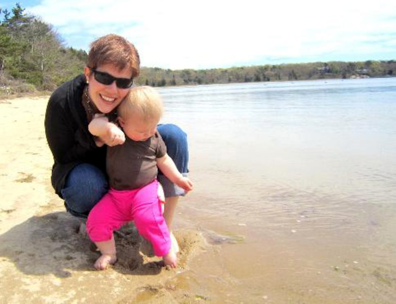 Katie Hampton, Osan Middle School special education teacher and breast cancer survivor, and her daughter, Abigale, test the water at Waquiot Bay, Mass., May 7, 2012. Hampton stayed with several family members, including her aunt, Rev. Nell Fields, during her cancer treatment at Massachusetts General Hospital. (Courtesy photo/Katie Hampton)