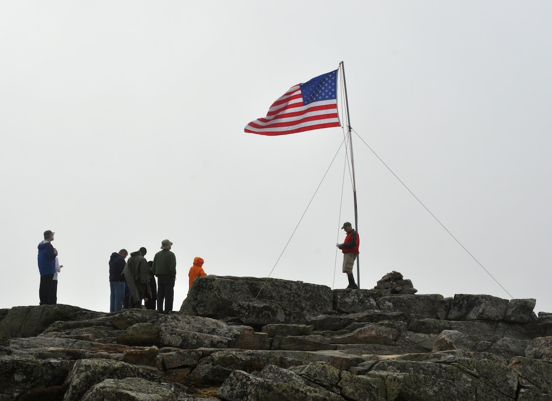 Chief Master Sgt. Scott Taatjes (center) recites a non-denominational prayer,  Bond Cliff, Lincoln, New Hampshire Sept. 14, 2013. The personnel, from the New Hampshire Air National Guard's 157th Air Refueling Wing participated in the annual Flags On The 48 event which is s memorial hike to commemorate 9/11.  (Courtesy photo Richard Blais)