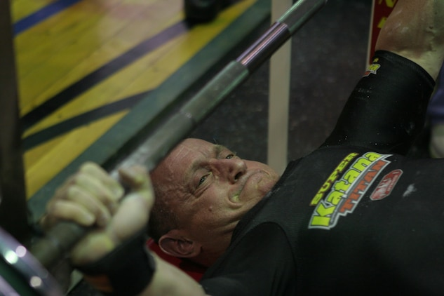 Abe Roman, 181-pound winner and overall male winner, bench presses 374 pounds during the 2012 open bench challenge at the IronWorks Gym sports courts here Jan. 21. Approximately 22 competitors took part in the competition, competing in a total of nine weight classes.