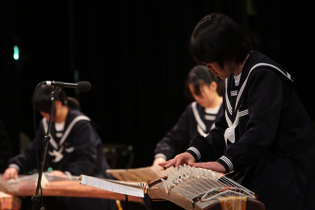 A Japanese student plays a koto during the U.S.-Japan Friendship Concert Feb. 18 at Iwakuni Civic Hall. The Japanese students played songs such as 'Somebody Somewhere,' 'National Emblem March' and several others.