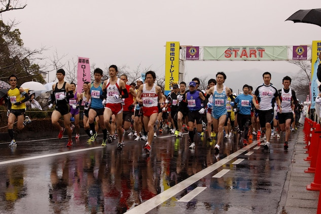 American and Japanese runners sprint away from the starting line during the 6th annual Kintai Road Race near the Kintai Bridge Sunday. More than 2,200 running enthusiasts, including more than 30 Marines, sailors and station residents, competed in a unique cultural experience between two athletic cultures.