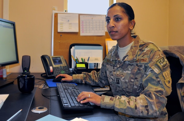 Capt. Dimple Nolly, 455th Air Expeditionary Wing deputy staff judge advocate, deployed from Spangdahlem Air Base, Germany, and a Houston native, works in her office at Bagram Airfield, Afghanistan, Oct. 29, 2013.