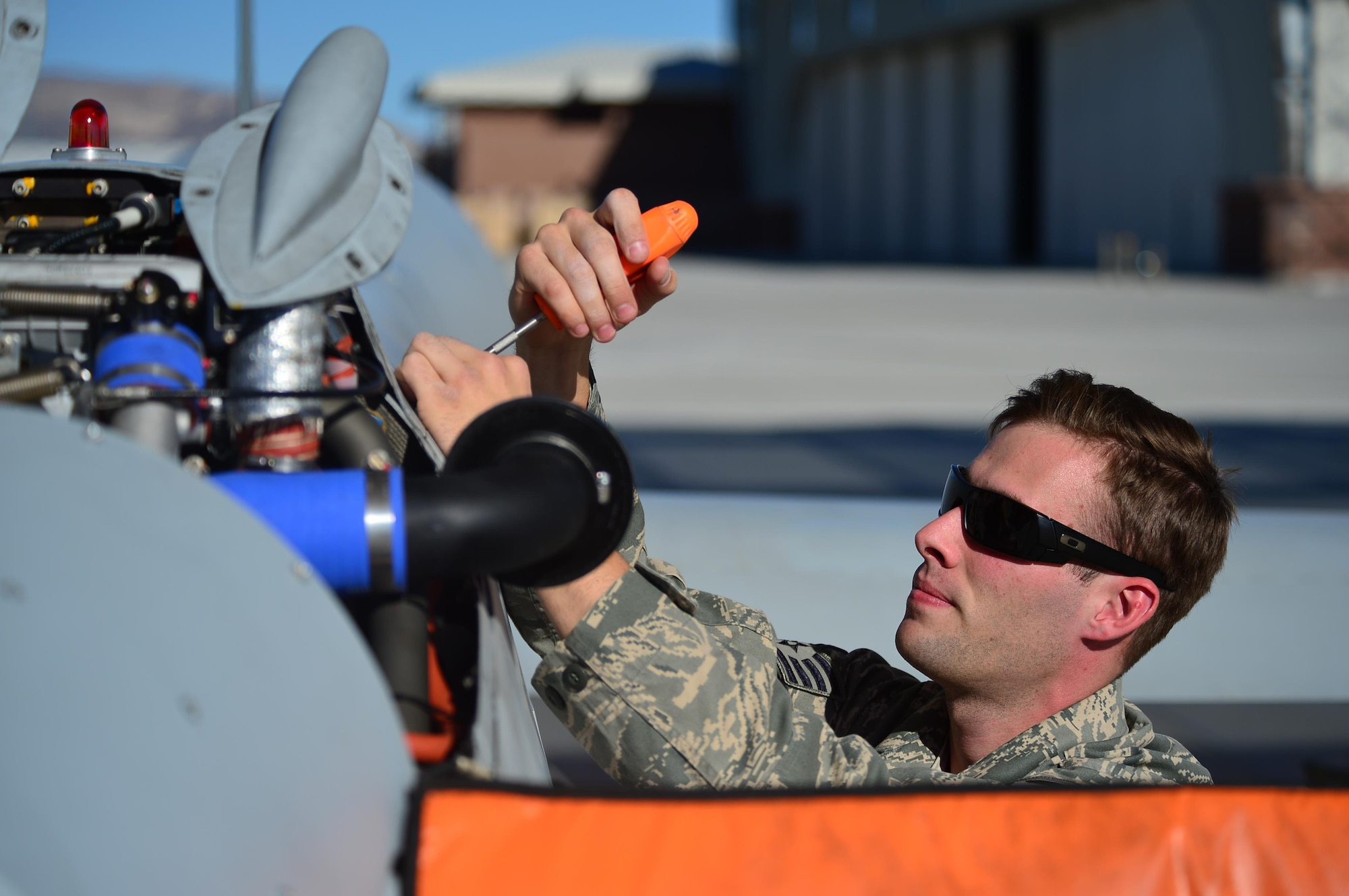 A crew chief from the 432nd Aircraft Maintenance Squadron de-panels an MQ-1 Predator remotely piloted aircraft during a post-flight inspection Nov. 1, 2013. Predators can perform the following missions and tasks: intelligence, surveillance, reconnaissance, close air support, combat search and rescue, precision strike, buddy-lase, convoy/raid overwatch, route clearance, target development, and terminal air guidance. The MQ-9 Reaper and MQ-1 Predator fleet surpassed 2 million cumulative flight hours on Oct. 22, 2013.