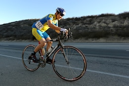 """David Woo pedals up a hill known as """"Mateo Mountain"""" during the Toujours Fidele-Tour de Camp Pendleton in San Mateo Nov. 2. The 100, 75, 50 and 25-mile tours took bicyclists down Basilone Road, past the air station, and North on Stuart Mesa Road. The 5.5-mile Family Fun Ride took riders north through Camp Talega and back."""